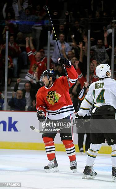 Andrew Brunette of the Chicago Blackhawks celebrates his goal in front of Jamie Benn of the Dallas Stars during the first period on October 8 2011 at...