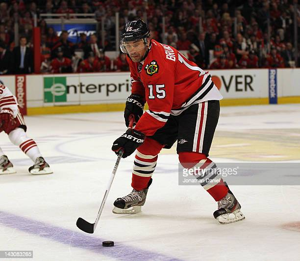 Andrew Brunette of the Chicago Blackhawks controls the puck against the Phoenix Coyotes in Game Three of the Western Conference Quarterfinals during...