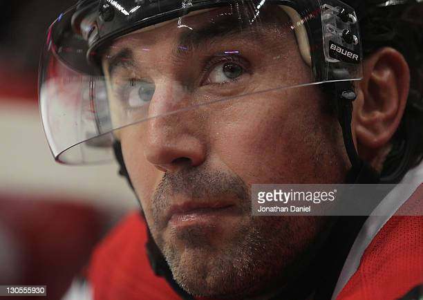 Andrew Brunette of the Chicago Blackhawks looks into the stands from the bench against the Anaheim Ducks at the United Center on October 25 2011 in...