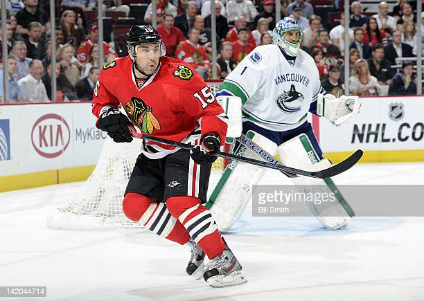 Andrew Brunette of the Chicago Blackhawks skates in front of goalie Roberto Luongo of the Vancouver Canucks during the NHL game on March 21 2012 at...