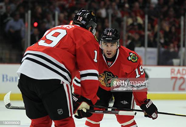 Andrew Brunette of the Chicago Blackhawks talks with teammate Jonathan Toews during a game against the Anaheim Ducks at the United Center on October...