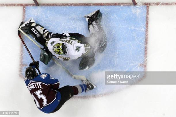 Andrew Brunette of the Colorado Avalanche scores against Marty Turco of the Dallas Stars during Game 4 of the Western Conference Quarterfinals on...