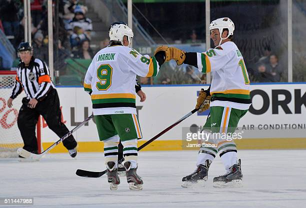 Andrew Brunette of the Minnesota North Stars/Wild Alumni celebrates his penalty shot goal with teammate Dennis Maruk during the 2016 Coors Light...