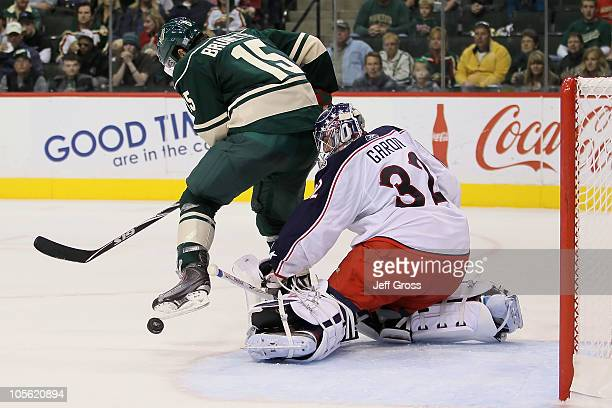 Andrew Brunette of the Minnesota Wild deflects a shot in front of goaltender Mathieu Garon of the Columbus Blue Jackets during the third period at...