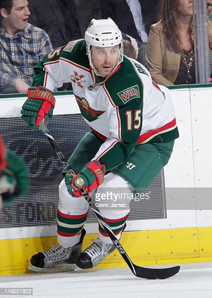 Andrew Brunette of the Minnesota Wild handles the puck against the Dallas Stars at the American Airlines Center on March 11 2011 in Dallas Texas