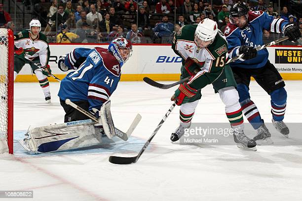 Andrew Brunette of the Minnesota Wild shoots against goaltender Craig Anderson of the Colorado Avalanche as Ryan O'Byrne defends at the Pepsi Center...