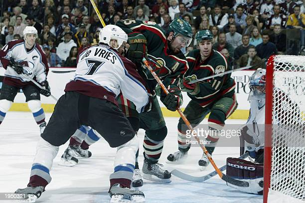 Andrew Brunette of the Minnesota Wild shoves the puck past goalie Patrick Roy of the Colorado Avalanche for a goal in game seven of the first round...