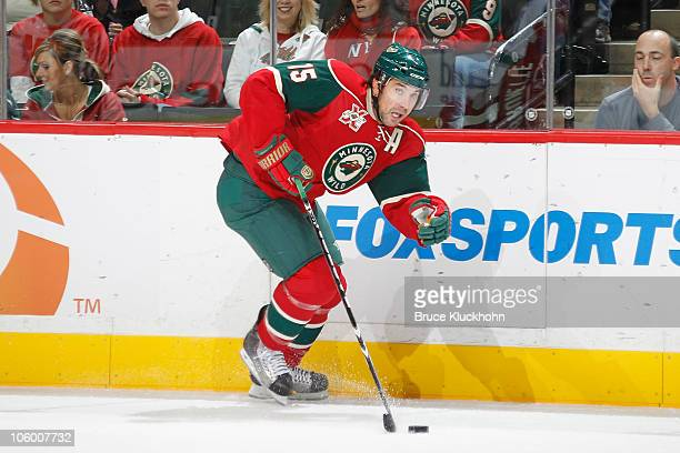 Andrew Brunette of the Minnesota Wild skates with the puck against the Vancouver Canucks during the game at the Xcel Energy Center on October 19 2010...