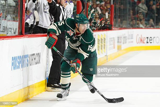 Andrew Brunette of the Minnesota Wild skates with the puck against the Los Angeles Kings during the game at the Xcel Energy Center on October 25 2010...