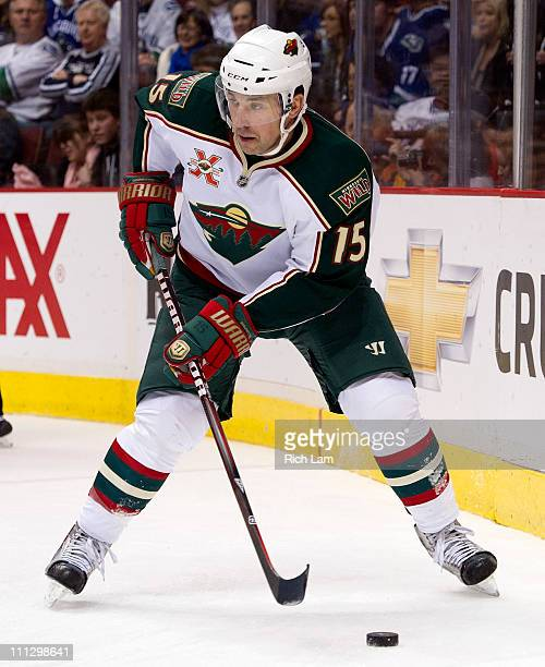 Andrew Brunette of the Minnesota Wild skates with the puck during NHL action against the Vancouver Canucks on March 14 2011 at Rogers Arena in...