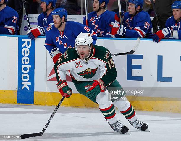 Andrew Brunette of the Minnesota Wild skates with the puck in the first period against the New York Rangers on March 3 2011 at Madison Square Garden...
