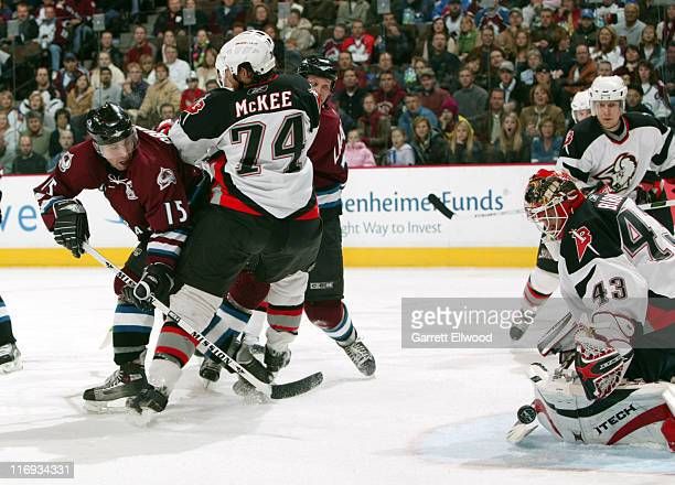 Andrew Brunette#15 of the Colorado Avalanche shoots on Martin Biron of the Buffalo Sabres during the game on December 4 2005 at Pepsi Center in...