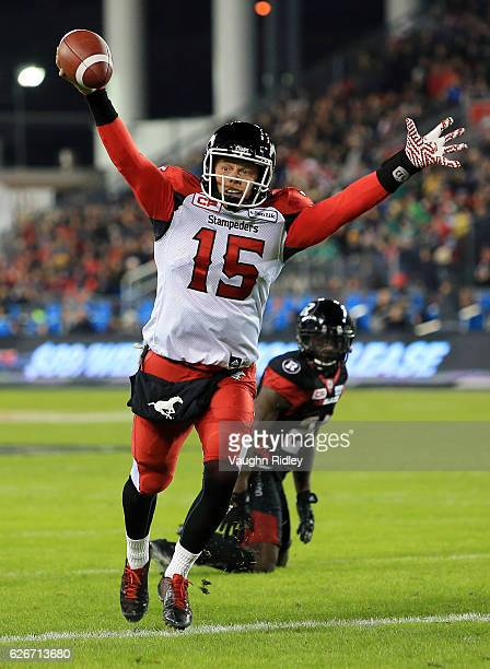 Andrew Buckley of the Calgary Stampeders scores a touchdown during the second half of the 104th Grey Cup Championship Game against the Ottawa...