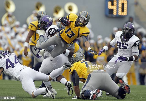 Andrew Buie of the West Virginia Mountaineers carries the ball against the TCU Horned Frogs during the game on November 3 2012 at Mountaineer Field...
