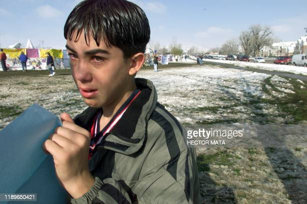 Andrew Burgos from the Columbine High School cries as he places a panel at the Clement Park memorial site in Littleton CO 24 April 1999 Memorial...
