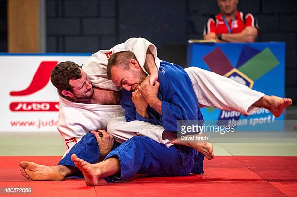 Andrew Burns of Great Britain attempts to strangle Tobias Meier of Switzerland into submission without success but eventually won the contest by...