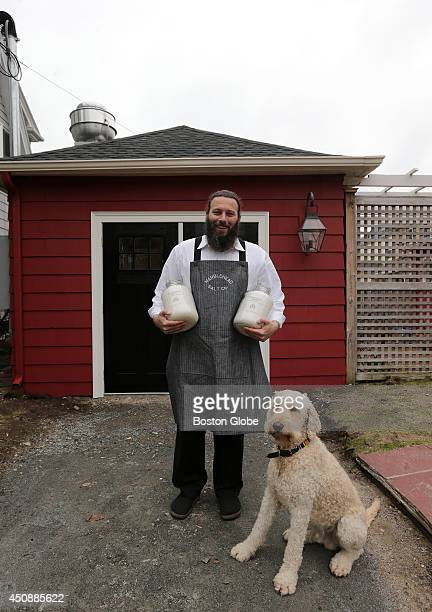 Andrew Bushell, owner of Marblehead Salt Co., and his dog, Theo.