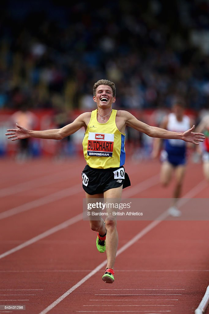 Andrew Butchart of Central Athletics Club raises his arms as he crosses the line to win the men's 5000 metres final during the British Championships at Birmingham Alexander Stadium on June 25, 2016 in Birmingham, England.