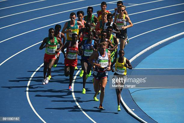 Andrew Butchart of Great Britain and Phillip Kipyeko of Uganda leads the pack in the Men's 5000 metres round 1 on Day 12 of the Rio 2016 Olympic...
