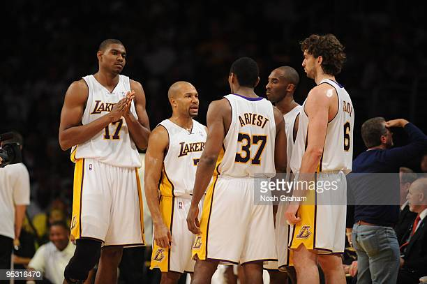 Andrew Bynum Derek Fisher Ron Artest Kobe Bryant and Pau Gasol of the Los Angeles Lakers look on during a game against the Cleveland Cavaliers at...