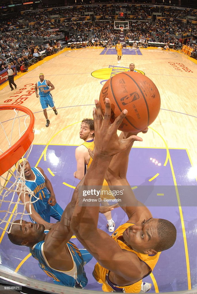 Andrew Bynum #17 of the Los Angeles Lakers attempts a shot against Emeka Okafor #50 of the New Orleans Hornets at Staples Center on December 1, 2009 in Los Angeles, California.