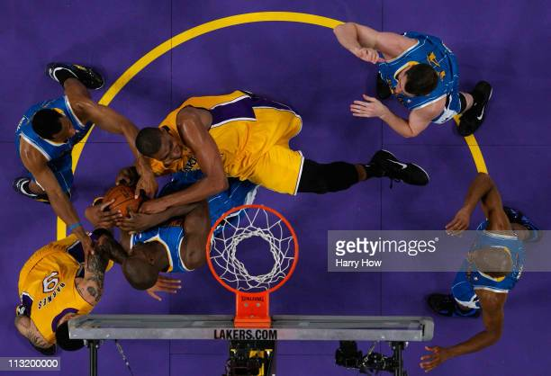 Andrew Bynum of the Los Angeles Lakers battles for the ball with Emeka Okafor of the New Orleans Hornets in Game Five of the Western Conference...