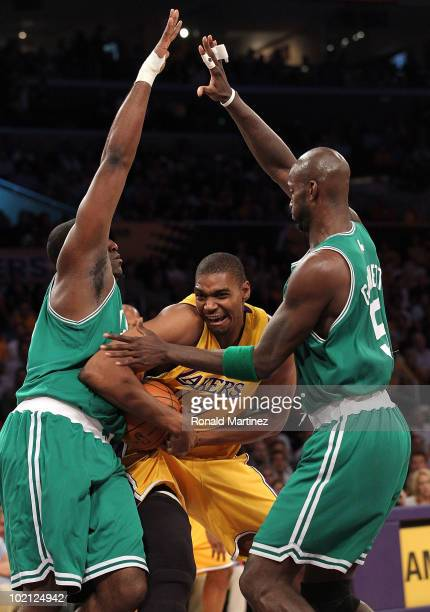 Andrew Bynum of the Los Angeles Lakers drives through Kendrick Perkins and Kevin Garnett of the Boston Celtics in the first period of Game Six of the...