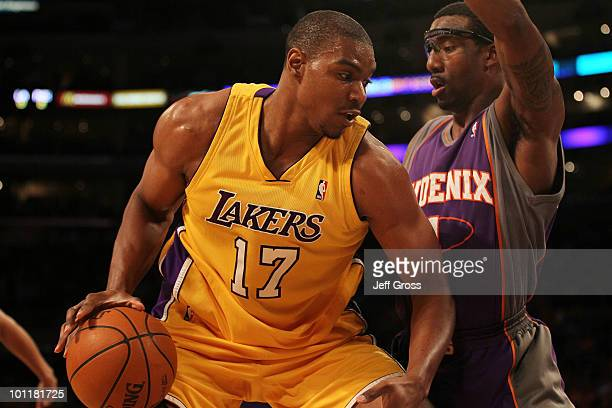 Andrew Bynum of the Los Angeles Lakers drives with the ball against Amar'e Stoudemire of the Phoenix Suns in the first quarter of Game Five of the...