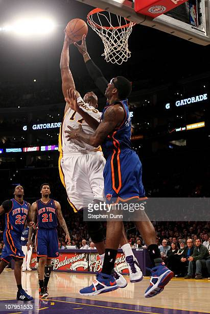 Andrew Bynum of the Los Angeles Lakers dunks over Amar'e Stoudemire of the New York Knicks at Staples Center on January 9 2011 in Los Angeles...