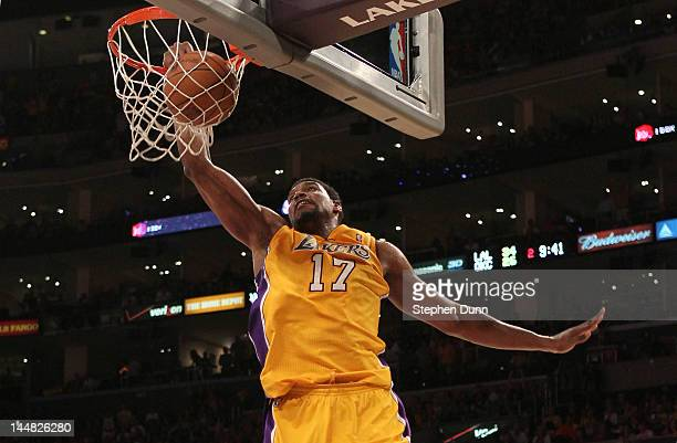 Andrew Bynum of the Los Angeles Lakers dunks the ball in the second quarter while taking on the Oklahoma City Thunder in Game Four of the Western...