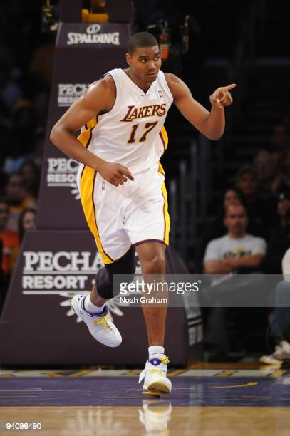 Andrew Bynum of the Los Angeles Lakers gestures during a game against the Phoenix Suns at Staples Center on December 6 2009 in Los Angeles California...
