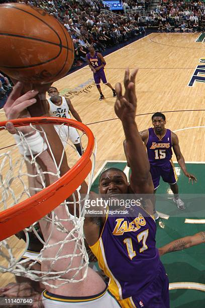 Andrew Bynum of the Los Angeles Lakers goes for the layup against Kyrylo Fesenko of the Utah Jazz at EnergySolutions Arena on April 1 2011 in Salt...