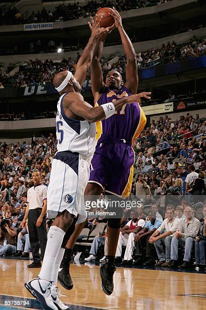 Andrew Bynum of the Los Angeles Lakers goes up for a shot over Erick Dampier of the Dallas Mavericks during the game on November 11 2008 at American...