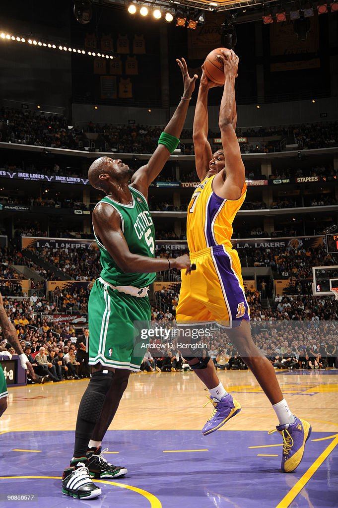 Andrew Bynum #17 of the Los Angeles Lakers has his shot challenged by Kevin Garnett #5 of the Boston Celtics at Staples Center on February 18, 2010 in Los Angeles, California.