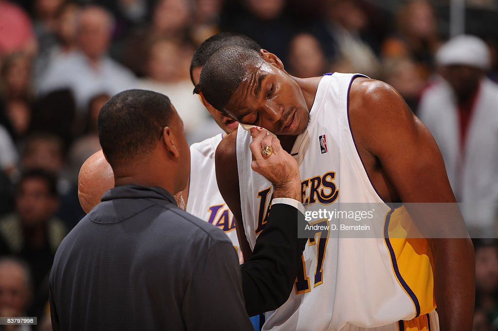Andrew Bynum #17 of the Los Angeles Lakers is tended to after sustaining a cut during the game against the Sacramento Kings at Staples Center on November 23, 2008 in Los Angeles, California.