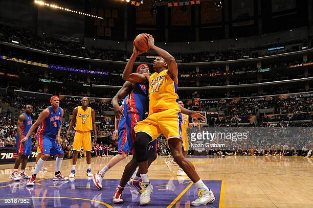 Andrew Bynum of the Los Angeles Lakers makes a move against Kwame Brown of the Detroit Pistons at Staples Center on November 17 2009 in Los Angeles...