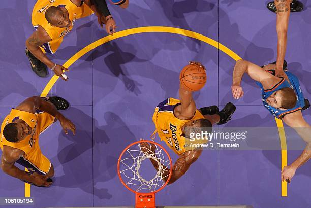Andrew Bynum of the Los Angeles Lakers pulls down a rebound against the Oklahoma City Thunder at Staples Center on January 17 2011 in Los Angeles...