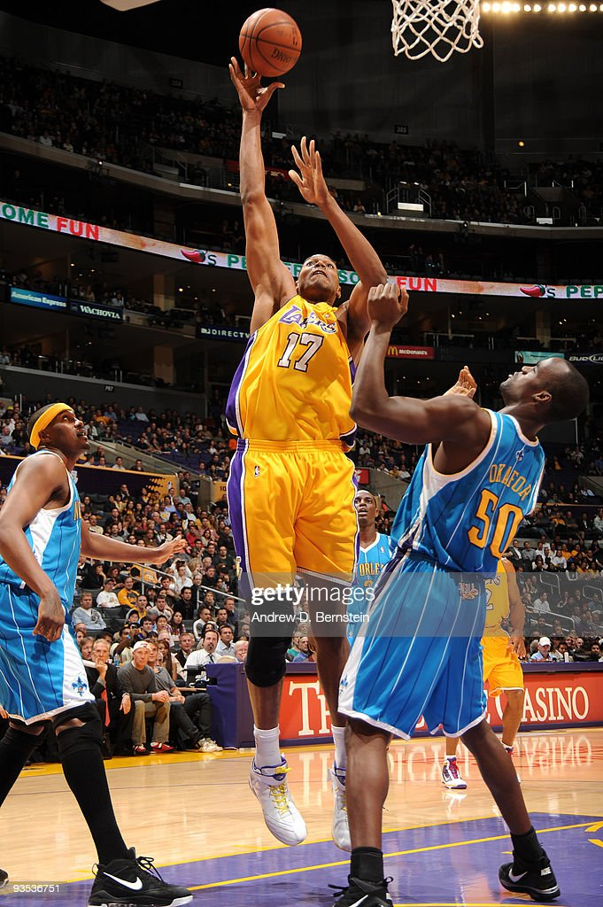 Andrew Bynum #17 of the Los Angeles Lakers puts up a shot against Emeka Okafor #50 of the New Orleans Hornets at Staples Center on December 1, 2009 in Los Angeles, California.