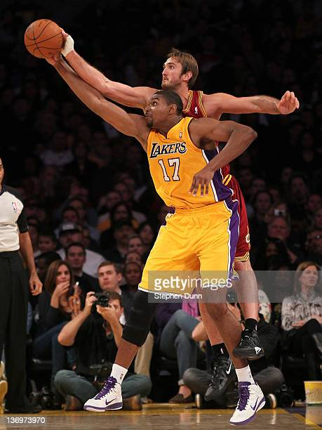 Andrew Bynum of the Los Angeles Lakers reaches for a pass as Semih Erden of the Cleveland Cavaliers tries to knock it away at Staples Center on...