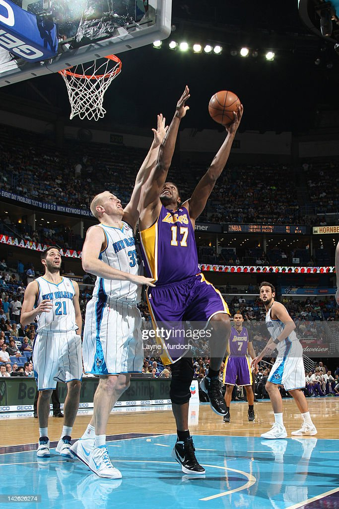 Andrew Bynum #17 of the Los Angeles Lakers shoots against Chris Kaman #35 of the New Orleans Hornets on April 9, 2012 at the New Orleans Arena in New Orleans, Louisiana.
