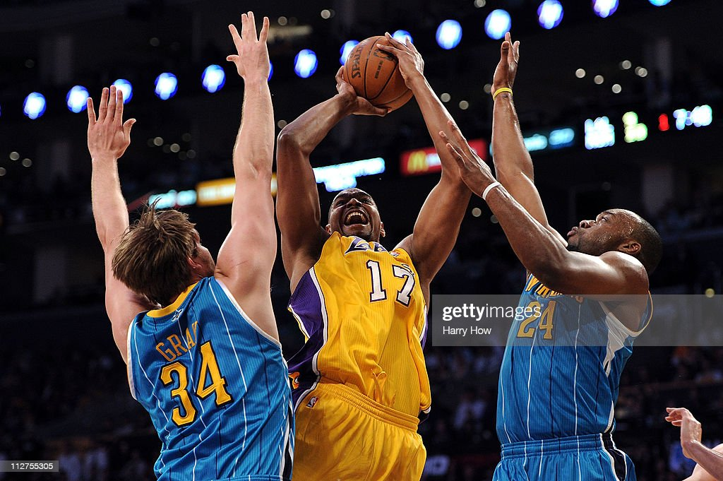 Andrew Bynum #17 of the Los Angeles Lakers shoots over Aaron Gray #34 and Carl Landry #24 of the New Orleans Hornets in the first quarter in Game Two of the Western Conference Quarterfinals in the 2011 NBA Playoffs on April 20, 2011 at Staples Center in Los Angeles, California.