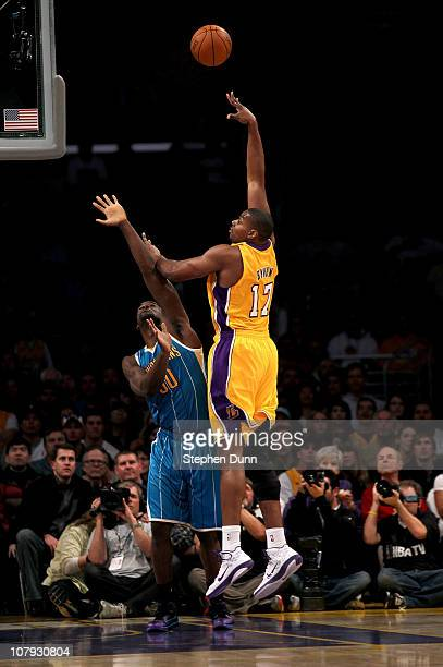 Andrew Bynum of the Los Angeles Lakers shoots over Emeka Okafor of the New Orleans Hornets at Staples Center on January 7 2011 in Los Angeles...