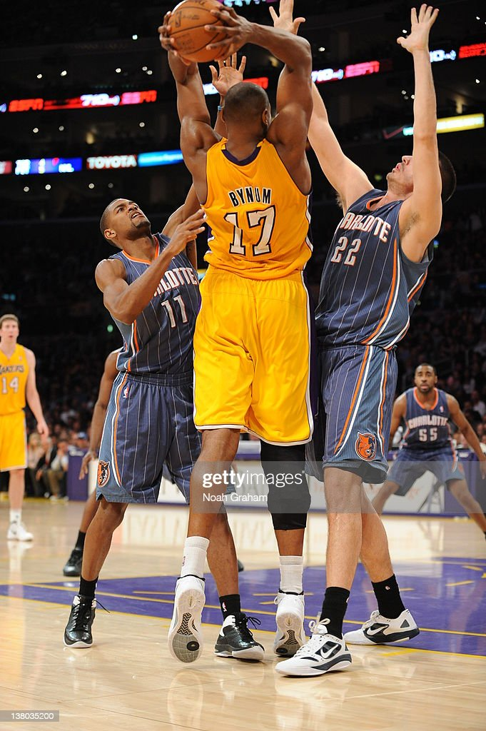 Andrew Bynum #17 of the Los Angeles Lakers splits defense of Cory Higgins #11 and Byron Mullens #22 of the Charlotte Bobcats during the game between the Los Angeles Lakers and the Charlotte Bobcats at Staples Center on January 31, 2012 in Los Angeles, California.