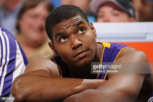 Andrew Bynum of the Los Angeles Lakers watches from the bench in Game Six of the Western Conference Finals against the Denver Nuggets during the 2009...
