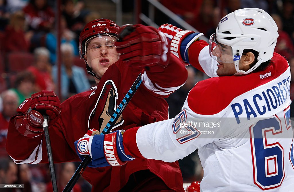 Andrew Campbell #45 of the Arizona Coyotes scrums with Max Pacioretty #67 of the Montreal Canadiens during the third period of the the NHL game at Gila River Arena on March 7, 2015 in Glendale, Arizona. The Canadiens defeated the Coyotes 2-0.