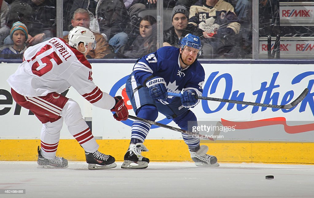 Andrew Campbell #45 of the Arizona Coyotes skates to check Leo Komarov #47 of the Toronto Maple Leafs during an NHL game at the Air Canada Centre on January 29, 2015 in Toronto, Ontario, Canada. The Coyotes defeated the Leafs 3-1.