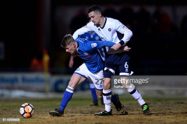 Andrew Cannon of Rochdale AFC is challenged by Shaun Williams of Millwall during The Emirates FA Cup Fourth Round match between Rochdale AFC and...