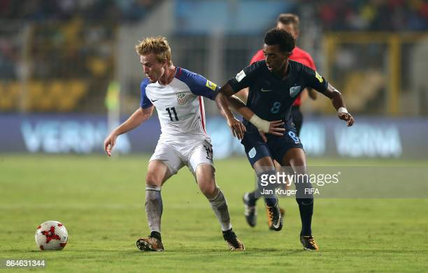 Andrew Carleton of United States of America competes with Tashan OakleyBoothe of England during the FIFA U17 World Cup India 2017 Quarter Final match...