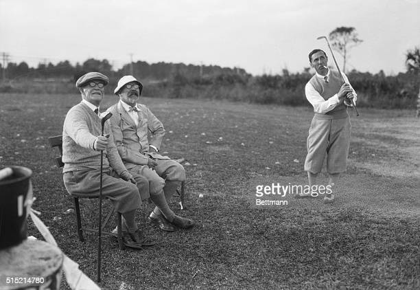 Andrew Carnegie II and George Crocket learning how to play golf from local golf pro Wilfred Reid in St Augustine Florida
