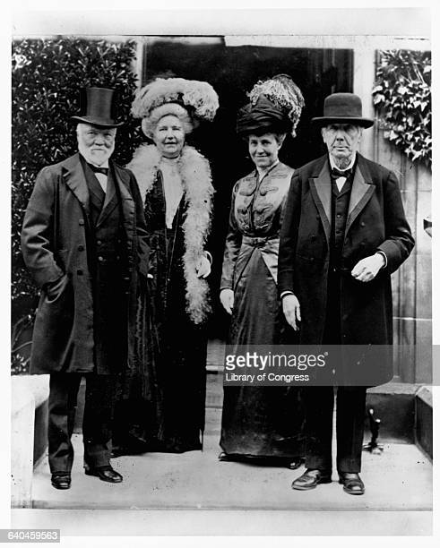 Andrew Carnegie stands next to his wife Louise and their guests